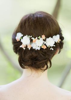 "An ornate silk flower hairpiece accented with tiny pearls and budding vines. Tiny peach colored flowers on the twigs. The vines are wired inside, and easily bendable to fit your hairstyle. This exquisite vine measures 7"" from end to end, and secures in the hair with an alligator hair clip on the back. Color: white, peach, light green Alligator clip backing Materials: silk-like flowers Hand crafted in my Missouri studio, of imported materials Made to order. Please allow 2-4 weeks..."
