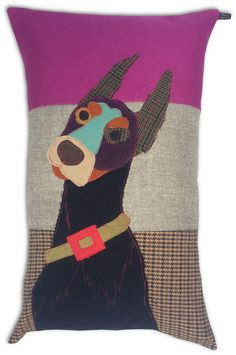 Prince the Dobermancushion, made with a combination of vintage and modern upholstery fabrics.  The dog is made out of precisely cut out pieces of fabric to create its character, and topstitched in red.  With mole grey cotton/linen backing. Includes 60 x 40cm luxury...