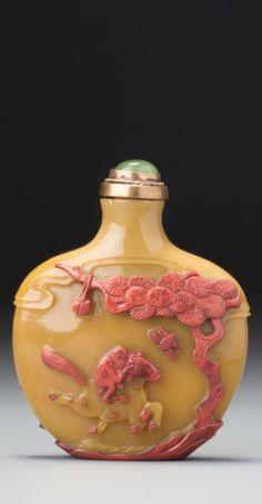 A CINNABAR-RED OVERLAY CARAMEL-BEIGE GLASS 'THREE GOATS' SNUFF BOTTLE<br>YANGZHOU, QING DYNASTY, 19TH CENTURY   lot   Sotheby's