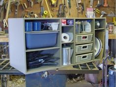Camping kitchen. I like the idea of the plastic trays as drawers. No space for the Coleman stove though... A few good concepts here that could be incorporated into ours.