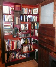 """Bookshelves I designed for my home office.  I took the idea from the Chinese display shelves & """"blew"""" it up to a 7' tall bookshelf which curled around a corner.  We didn't add a back, just backed the shelves against the wall & then painted the interiors."""
