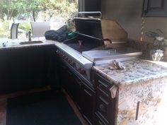 A patio grilling station can entertain guests as well as serve as a built in bar