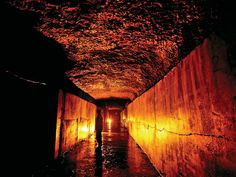 FORT BONIFACIO TUNNEL in Taguig, Metro Manila, Philippines - A man walks inside the Fort Bonifacio Tunnel in Taguig, dug by Igorots in the early 1900s. The tunnel is approximately 30 meters below the surface, 4 meters wide and passable through a length of about 2.24 kilometers.