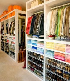 A closet that makes sense -- a built-in organization system that includes shoe shelves on the bottom, sweater shelves followed by a place to hang clothing