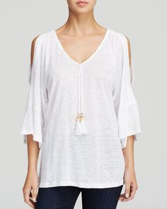 Moon & Meadow Cold Shoulder Linen Top - I love the flow of this top as well as it's simplicity.   It can be easily assimilated into a wardrobe in a number of ways.   Personally I'd love to wear it with jeans and a chunky gold bangle, but I can see it looking good with a long flowing skirt as well.........