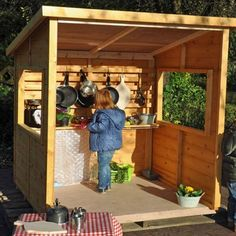 The Home Corner Shelter is a super duper outdoor kitchen hut complete with counter and trellis back. Perfect for mud pie kitchens, writing centre, investigation centre or as an outside home corner or shop.  A really flexible piece of equipment. Play Corner, Corner House, Mud Pie Kitchen, Outdoor Shelters, Outdoor Play, Play Houses, Trellis, Counter, Kitchens