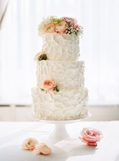 Textured floral-topped wedding cake: http://www.stylemepretty.com/destination-weddings/2016/02/09/whimsical-pastel-winter-fairy-tale-wedding/ | Photography: Peter & Veronika - http://peterandveronika.com/language/en/