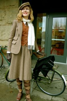 Magnificent vintage tweed ensemble. D and L are off to school on their bikes!