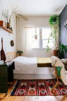 Tiny Bedroom Ideas for Small-Space Dwellers | Domino -- the old vintage work station as a night table....