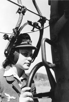 German female soldier listening for enemy aircraft, WW2
