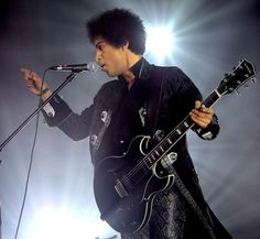 Prince performing on the Live Out Loud tour