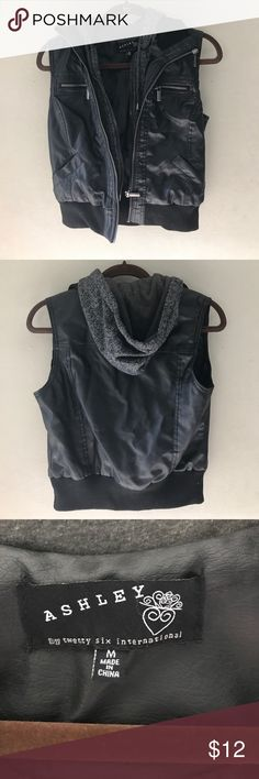 Leather sleeveless sewn in hooded sweatshirt Very cute leather/sweatshirt vest with hood. Zippers work and all pockets are functional.  I would say true medium.   Just don't wear anymore. Ashley By 26 International Jackets & Coats Vests