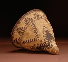 Northern California Twined Burden Basket, Pitt River, c. 1900, the conical form with two-color quail feather pattern, (minor stitch loss at rim), ht. 12, dia. 12 1/2 in.