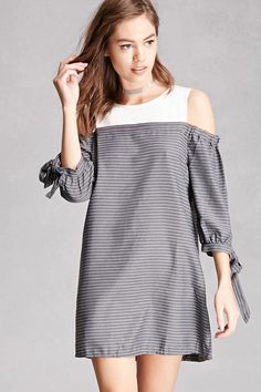 A woven shift dress featuring a solid yoke with a round neckline, sleeveless cut, a button-keyhole back, and a pinstripe body, and 3/4 sleeves with elasticized arm bands and self-tie cuffs. This is an independent brand and not a Forever 21 branded item.