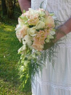 I like this style, a simple teardrop bouquet, using pale pink Lisianthus and perhaps just a touch of the warmer hot pink roses among the white.