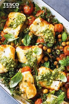Add this baked halloumi with chickpeas and greens to your summer meal plans. Melting halloumi, crispy chickpeas and sweet juicy tomatoes are finished with a drizzle of pesto for dinner in under 30 mins. Vegetarian Dinners, Vegetarian Recipes, Cooking Recipes, Healthy Recipes, Vegetarian Cheese, Cooking Cake, Veggie Dinners, Cooking Tools, Cooking Ideas
