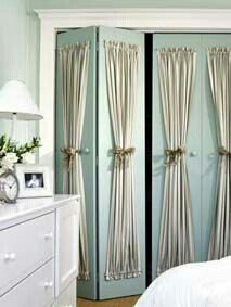 So easy and cheap to add curtains to wood closet doors. Looks so classy and chic