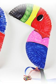 Toucan Sam Window Art.  Celebrate summer with a colorful display of Toucan Sam art your kids can make from paper plates, markers and ribbons.