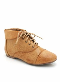 For whatever reason, I'm really interested in this style. I like the light color and the cute laces, like I said before. The folded top usually doesn't go well with me, but as far as oxford booties are concerned, that's a must.