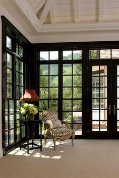 Divided windows with dark trim...dramatic.