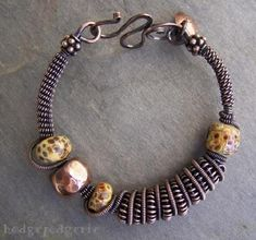 This lampwork and copper bangle reminds one of the warm valleys of Tuscany, Italy.