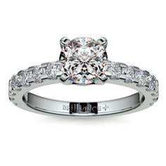Four-Prong Scallop Diamond Engagement Ring in Platinum Fourteen round cut diamonds are prong set in this four-prong scallop diamond ring setting in platinum. Approximately 3/8 carat total diamond weight and proudly made in the USA.