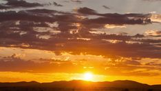 Static timelapse at sunset with a silhouette mountain range and clouds rollings past against dramatic golden and orange sky going dark. African Sunset, Sunset Silhouette, Orange Sky, Mountain Range, Hd Video, Stock Footage, Sunsets, Past, Clouds