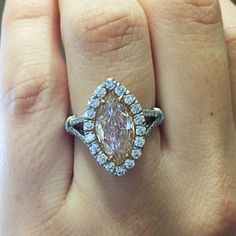Fancy light pink marquise halo