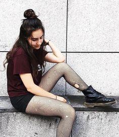 Wine printed shirt with black denim shorts, fishnet leggings & Dr Martens boots by xcvmillex