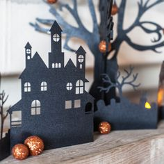 How about a little spooky village for your Halloween decorations. Cut from card stock paper the village will stand on your mantel, shelf or dining table.