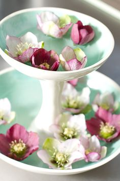 Filled with flowers, this two-tiered bowl would make a stunning wedding centerpiece.