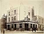 A view from the west showing people standing outside the D'Oyley Arms public house on Marlborough Road
