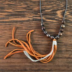 """-8mm Faceted eggplant freshwater pearls  -925 Sterling Silver, Leather, 100% Silk   -Length 15 inches + 2 inch extender   -6"""" Deer Hide Leather    This limited edition necklace is a real show stopper.  I have held onto these beautiful faceted pearls for a long time waiting for just the right design to come along.  They are freshwater pearls in a deep eggplant purple with iridescent hints of green and blue made more intense by the faceted cuts that add sparkle to them.  Ten of these little…"""