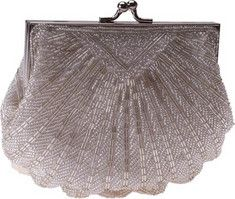Touch Ups handbag, Victoria, is unforgettable.This ivory seashell-inspired clutch is covered with intricate beading.Purse is complete with beautiful closure.
