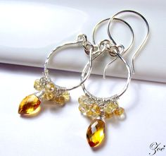 Lemon Essence  From my signature collection these earrings feature two exquisite wire wrapped AA+ grade citrine fancy cut drops, hand-formed sterling silver textured hoops, and hand-formed sterling silver shepherds hooks  #wirewrapped #wire #gems #handcrafted
