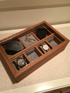 Classy storagebox for the gentlemans. Tie, clock's, pins and more. Made with American Oak and a touch of brown pickling. Hand ingraved silver details  Made by; Trond Olsen