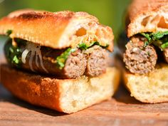 Grilled Merguez Sandwiches with Caramelized Onions, Manchego, and Harissa Mayonnaise