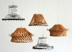Clothes hanger pendant lights. Could try spray painting the wood hangers a vibrant color...