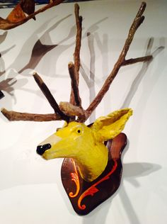Want a mounted deer head on your wall, don't want a real deer head? We have just the thing for you!! 'Yellow Caribou' by John Northcott is an unexpected kitsch deer head sculpture made of paper mache and tree branches, perfect for the vegan sensibilities.