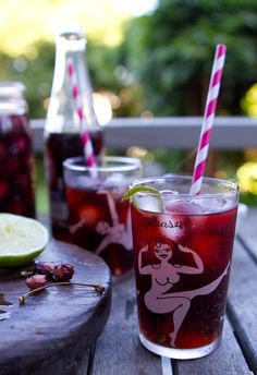 by Chez Us --- CHERRY VANILLA RUM & COKE. Love love the colors. This photograph is so juicy. It's making me desparately want a cherry coke, like, RIGHT NOW. That's a winner. (I think I'd use a dark rum.. like Myers's)