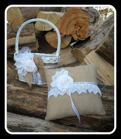 Burlap and Lace Ring Bearer Pillow and Flower Girl Basket Wedding Set For An Outdoor, Garden, Barn, Beach, Rustic, Or Elegant Wedding. $42.00, via Etsy. We could make this using turquoise or pink ribbon instead.