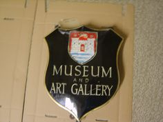 Old Bridport Museum and Art Gallery sign.  BRPMG 7054.