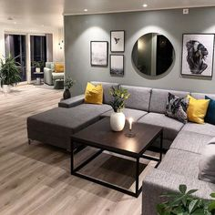 I like the arrangement of the picture frames and round mirror above the sofa. room wall decor ideas above couch Picture Arrangements Mirror Decor Living Room, New Living Room, Home And Living, Decor Room, Small Living, Modern Living, Bedroom Decor, Mirror Over Couch, Art Over Couch