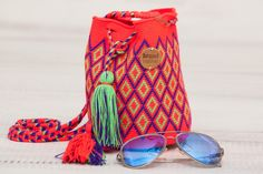 Claudita Bag - This beautiful & original brandnative mini wayuu mochila Bag is made by the Wayuu indigenous women of Guajira Colombia, it has taken up to 2 weeks to make, and is 100% handmade.