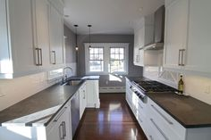 Galley kitchen, soapstone (?) countertops, gas range...officially swooning...