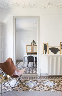 A HOME IN BARCELONA WITH A STUNNING TILE FLOOR | THE STYLE FILES