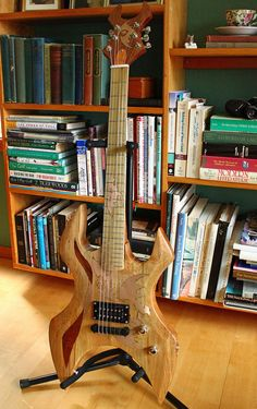 Handmade Electric Guitar with Copper Bat Inlays by ArtGuitars... what if the dark inlay shapes were soundholes?