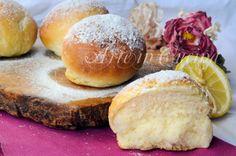 Bomboloni al limone, forno, ricetta facile, dolci lievitati, senza frittura, brioche profumate, da farcire, colazione, merenda, bomboloni sofficissimi, feste, buffet