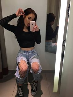 long sleeve black crop top + destroyed boyfriend jeans + fishnet leggings + converse
