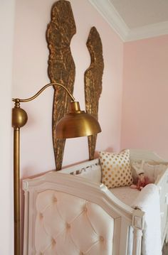 Pink and Gold Nursery Reveal I love the angel wings either in gold or ivory
